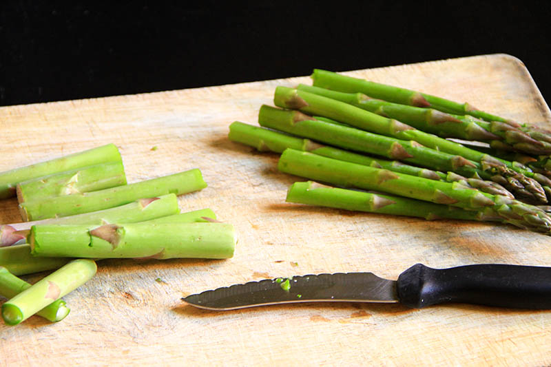 Cutted asparagus on a chopping board
